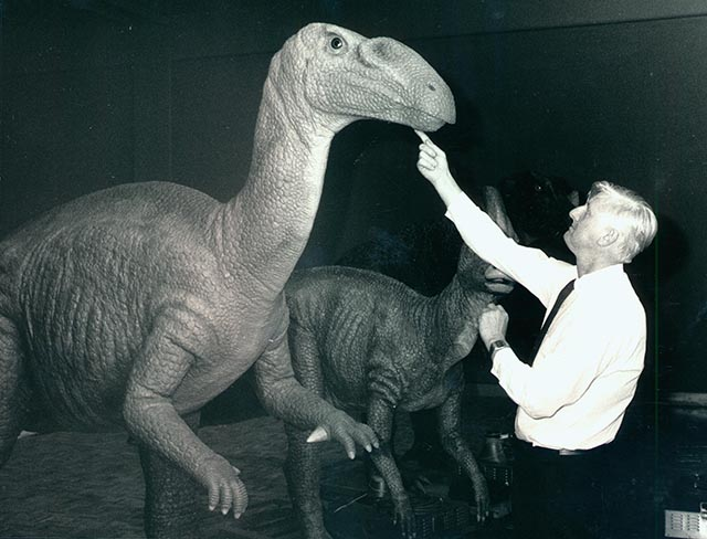 Mike Gore with a Muttaburrasaurus dinosaur, 1988