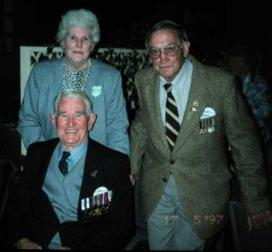 Ted Young, seated, with his wife Lucy and Alex Palmer in May 1997. Alex Palmer was the other 3rd Battalion soldier on the patrol. Image courtesy of Gavin Young.