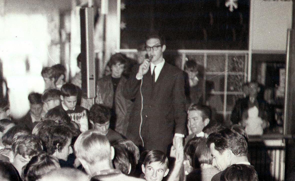 Peter Leonard addresses a crowd of radio station 2CA Listernrs, 1960s