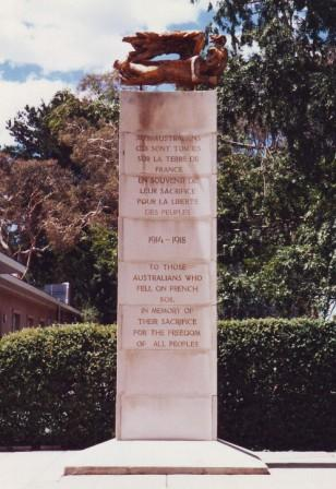 The 15 foot high French Australian memorial on Perth Avenue, Yarralumla, which consists of a sculpture sitting on top of a tall pillar.
